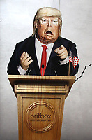 Caricature of US President Donald Trump on large advertisement board for satirical television puppet show Spitting Image inside Westminster Tube Station. London September 30th 2020<br /> <br /> Photo by Keith Mayhew