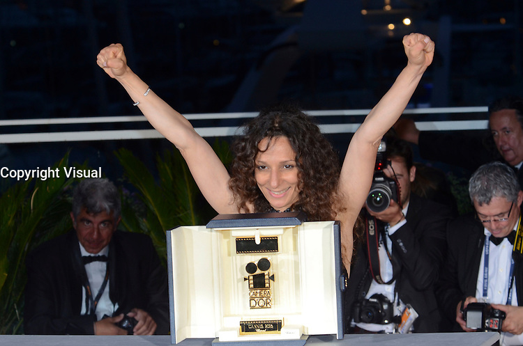 French Moroccan director Houda Benyamina poses with the Camera d'Or at the Palme D'Or Winner Photocall during the 69th annual Cannes Film Festival at the Palais des Festivals on May 22, 2016 in Cannes, France.