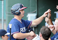 Catcher Evan Gattis (36) of the Rome Braves, Class A affiliate of the Atlanta Braves, in the second game of a doubleheader against the Greenville Drive on August 15, 2011, at Fluor Field at the West End in Greenville, South Carolina. (Tom Priddy/Four Seam Images)