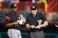 Richmond Flying Squirrels manager Miguel Ojeda (35) during the lineup exchange with umpire Randy Rosenberg a game against the Erie SeaWolves on May 27, 2016 at Jerry Uht Park in Erie, Pennsylvania.  Richmond defeated Erie 7-6.  (Mike Janes/Four Seam Images)
