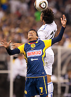Pedro Leon (right) heads the ball over Alonso Sandoval (left). Real Madrid defeated Club America 3-2 at Candlestick Park in San Francisco, California on August 4th, 2010.