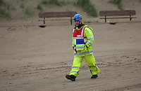 "Pictured: A Coastguard officer at Cefn Sidan beach, near Pembrey west Wales, UK. Saturday 21 May 2016<br /> Re: A suspected bomb washed up on a Welsh beach has been detonated a bomb disposal unit after a walker came across it at Cefn Sidan beach, west Wales.<br /> After the discovery, the beach, aprt of Pembrey Country Park in Carmarthenshire , was cordoned off.<br /> The device was subsequently detonated.<br /> A spokesman for HM Coastguard Swansea said: ""The bomb disposal team is on the scene dealing with the object and it has just been detonated.""<br /> ""We will now be clearing up the debris and making sure the beach is clean and safe."""
