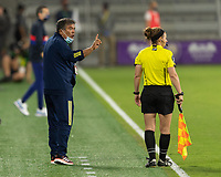ORLANDO, FL - JANUARY 22: Colombia head coach Nelson Abadia displays his opinion to the assistant referee during a game between Colombia and USWNT at Exploria stadium on January 22, 2021 in Orlando, Florida.