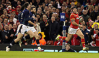 Tom James of Wales (R) makes a run during the RBS 6 Nations Championship rugby game between Wales and Scotland at the Principality Stadium, Cardiff, Wales, UK Saturday 13 February 2016