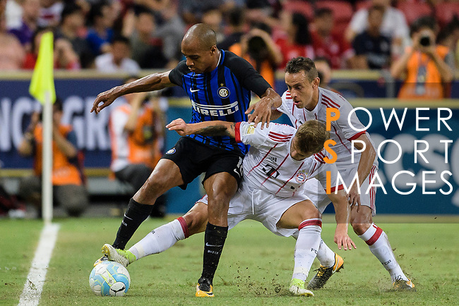 FC Internazionale Midfielder Joao Mario (L) fights for the ball with Bayern Munich Midfielder Niklas Dorsch (R) during the International Champions Cup match between FC Bayern and FC Internazionale at National Stadium on July 27, 2017 in Singapore. Photo by Weixiang Lim / Power Sport Images