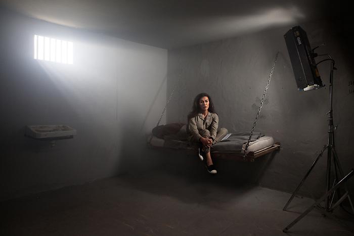 """Shooting of the series """"Jareemat Shaghaf"""" (""""Passionate Crime""""), Lebanon mars 2016 (Media 7 revolution). The lebanese star Nadine El Rasi plays the role of a prisoner. In the story, she is accused of having killed her husband, who in fact committed suicide after an unfortunate misunderstanding in the first episode. For the scene, the actress prefered to keep her beauty make up, the style being more important than realism for her.<br /> <br /> Tournage de la série """"Jareemat Shaghaf"""" (""""Crime Passionnel"""") Liban, Mars 2016 (Media revolution 7). La star libanaise Nadine El Rasi incarne le personnage d'une prisonnière. Dans l'intrigue, la belle prisonnière est accusée d'avoir assassiné son mari, qui s'était en fait suicidé sur un malentendu dans le premier épisode. Pour la scène, l'actrice préfère conserver son maquillage beauté à celui de prisonnière, privilégiant le style au réalisme du rôle."""