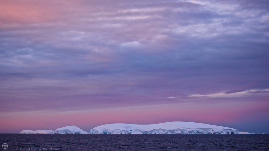 Sunset in Iceberg Alley in the Lemaire Channel, Antarctic peninsula.