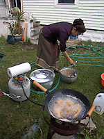 June , 2004 preparation and the festive meal for a traditional Laotian wedding in a family home in Providence, Rhode Island