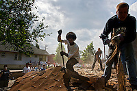 Volunteers with the non-profit organisation Motor City Blight Busters pull down a derelict house in Detroit, Michigan.