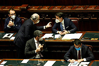 The Italian Premier Giuseppe Conte speaking with the Minister of Economy Roberto Gualtieri during the information at the Lower Chamber about the Government crisis..<br /> Rome(Italy), January 18th 2021<br /> Photo Samantha Zucchi/Insidefoto