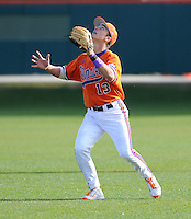 Second baseman Jay Baum (13) of the Clemson Tigers gets under a pop fly in a game against the University of Alabama-Birmingham on Feb. 17, 2012, at Doug Kingsmore Stadium in Clemson, South Carolina. UAB won 2-1. (Tom Priddy/Four Seam Images)