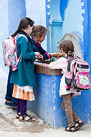 Chefchaouen, Morocco.  Young Schoolgirls at a Public Water Tap.