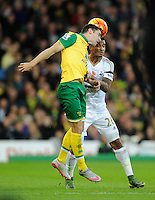 Robbie Brady of Norwich City and Kyle Naughton of Swansea City during the Barclays Premier League match between Norwich City and Swansea City played at Carrow Road, Norwich on November 7th 2015