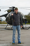 Pictured: John Bream stood today in front of the helicopter he would eventually be jumping out of.<br /> <br /> A daredevil former paratrooper today set a world record after he jumped 131ft into the sea from a helicopter without a parachute. John Bream, who is nicknamed 'John the Flying Fish', plummeted into the sea feet-first at 75mph as part of his daring stunt. <br /> <br /> The 34 year old, who fell for around four seconds before hitting the water, has set two records as a result of his dive, which he took on to raise awareness for veteran suicide. Mr Bream set a world record for the highest freefall into water from an aircraft and the record for jumping into British waters following today's leap into the Solent off Hayling Island, Hants. SEE OUR COPY FOR MORE DETAILS<br /> <br /> © Ewan Galvin/Solent News & Photo Agency<br /> UK +44 (0) 2380 458800