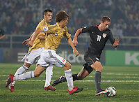 Nick Palodichuk (11) tries to out run Marc Muniesa (5). Spain defeated the U.S. Under-17 Men National Team  2-1 at Sani Abacha Stadium in Kano, Nigeria on October 26, 2009.