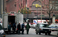 Alerte a la bombe au Centre-Ville , le 12 janvier 1997 au carré Philippe.<br /> <br /> <br /> Montreal (Qc) CANADA - Jan 12 1997 <br /> -File Photo -<br /> Police enter the perimeter around THE BAY store during a <br /> Bomb alert in downtown Montreal.