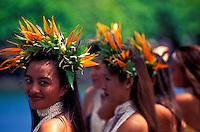 Head and shoulder shot of beautiful Tahitian dancers wearing bird of paradise haku leis.