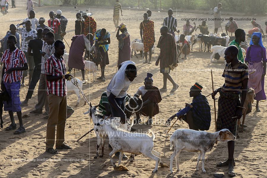 KENIA Turkana, Lodwar, cattle market, herder buy and sell goats / Turkana mit Ziegen auf dem Viehmarkt
