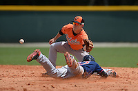 Infielder Alexander Simpson (12) of the Baltimore Orioles organization takes a throw as Max Kepler (27) slides in during a minor league spring training game against the Minnesota Twins on March 20, 2014 at Buck O'Neil Complex in Sarasota, Florida.  (Mike Janes/Four Seam Images)