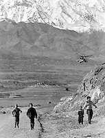 """Soviet Mi-24 """"Hind"""" attack helicopters escort a fuel convoy on its way to the Afghan capital Kabul on Sunday, February 5, 1989. Under siege for several years, the regime in Kabul depends heavily on Soviet military support."""