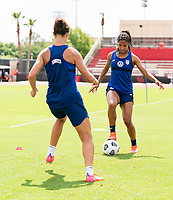 HOUSTON, TX - JUNE 12: Carli Lloyd #10 defends Margaret Purce #20 of the USWNT during a training session at University of Houston on June 12, 2021 in Houston, Texas.