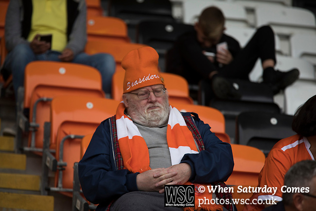 A home fan nods off during half-time in the near-deserted home stands at Bloomfield Road stadium as Blackpool hosted Portsmouth in an English League One fixture. The match was proceeded by a protest by around 500 home fans against the club's controversial owners Owen Oyston, many of whom did not attend the game. The match was won by the visitors by 2-1 with two goals by Ronan Curtis watched by just 4,154 almost half of which were Portsmouth supporters.