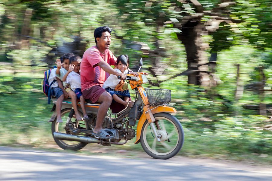 Cambodia.  Traffic Safety:  Man and Four Children on a Motorbike, no Helmet.