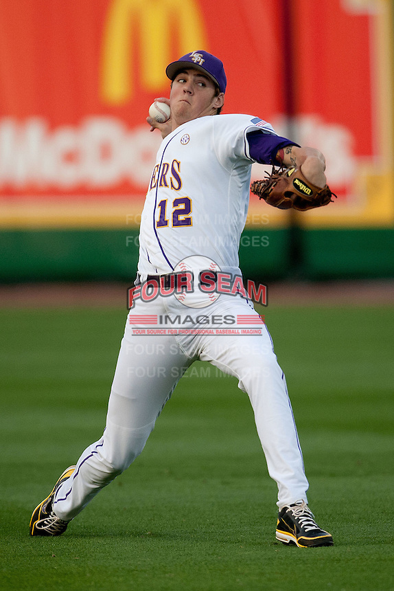 LSU Tigers starting pitcher Kevin Gausman #12 warms up before his start against the Mississippi State Bulldogs during the NCAA baseball game on March 16, 2012 at Alex Box Stadium in Baton Rouge, Louisiana. LSU defeated Mississippi State 3-2 in 10 innings. (Andrew Woolley / Four Seam Images)