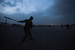 """A relaxing game of whiffle ball on a quiet evening. Scenes from the medical evacuations of wounded Americans, Canadians, and Afghan civilians and soldiers being flown by Charlie Co. 6th Battalion 101st Aviation Regiment of the 101st Airborne Division. Charlie Co. - which flies under the call-sign """"Shadow Dustoff"""" - flies into rush the wounded to medical care out of bases scattered across Oruzgan, Kandahar, and Helmand Provinces in the Afghan south. These images were taken of missions flown out of Kandahar Airfield in Kandahar Province and Camp Dwyer in Helmand Province."""