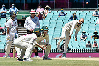 11th January 2021; Sydney Cricket Ground, Sydney, New South Wales, Australia; International Test Cricket, Third Test Day Five, Australia versus India; Nathan Lyon of Australia bowls as Matthew Wade and Marnus Labuschagne of Australia crowd the bat