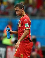 Water drips from the chin of Eden Hazard of Belgium