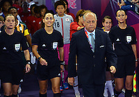 July 31, 2012..FIFA coordinator leads the game officials and the  players on to the field before group F Women's Football match between JPN and RSA at the Millennium Stadium on day four of 2012 Olympic Games in Cardiff, United Kingdom...