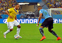 RIO DE JANEIRO - BRASIL -28-06-2014. Camilo Zuñiga (#18) jugador de Colombia (COL) disputa un balón con Alvaro Pereira (#6) jugador de Uruguay (URU) durante partido de los octavos de final por la Copa Mundial de la FIFA Brasil 2014 jugado en el estadio Maracaná de Río de Janeiro./ Camilo Zuñiga (#18) player of Colombia (COL) fights the ball with Alvaro Pereira (#6) player of Uruguay (URU) during the match of the Round of 16 for the 2014 FIFA World Cup Brazil played at Maracana stadium in Rio do Janeiro. Photo: VizzorImage / Alfredo Gutiérrez / Contribuidor