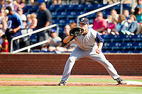 First baseman Jim Gallagher #10 of the Charlotte Knights waits for a throw during the game against the Durham Bulls at Durham Bulls Athletic Park on August 28, 2011 in Durham, North Carolina.   (Brian Westerholt / Four Seam Images)