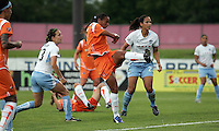 Chicago defenders Natalie Spilger (13) and Jill Oakes (24) look on helplessly as Sky Blue's Rosanna (11)  buries one in the net.  Sky Blue defeated the Chicago Red Stars 1-0 in a mid-week game, Wednesday, June 17, at Yurcak Field.