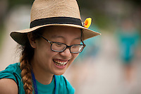 """Amber Huang shares a laugh during """"Circle the City with Service,"""" the Kiwanis Circle K International's 2015 Large Scale Service Project, on Wednesday, June 24, 2015, in Indianapolis. (Photo by James Brosher)"""