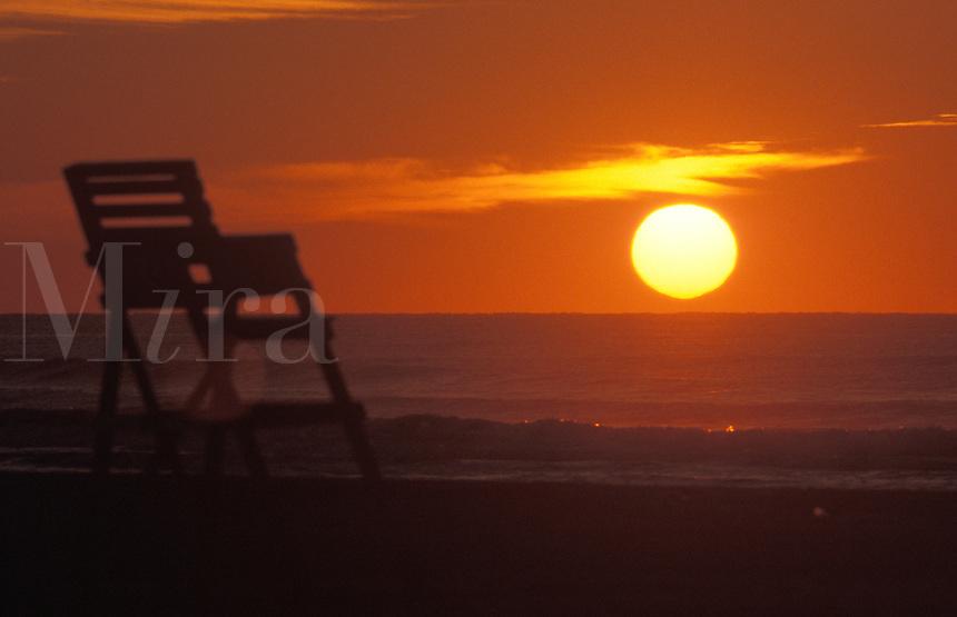 The sun rises over the Atlantic Ocean.