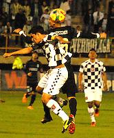 TUNJA - COLOMBIA -07 -03-2014: Juan Mahecha (Izq.) jugador de Boyaca Chico FC disputa el balón con Luis Paez (Der.) jugador de Atletico Nacional, durante partido aplazado de la octava fecha de la Liga Postobon I-2014, jugado en el estadio La Independencia de la ciudad de Tunja. / Juan Mahecha (L) player  of Boyaca Chico FC vies for the ball with Luis Paez (R) player of Atletico Nacional during a match for the eighth date of the Liga Postobon I-2014 at the La Independencia  stadium in Tunjacity, Photo: VizzorImage  / Jose M. Palencia / Str. (Best quality available)