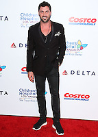 LOS ANGELES, CA, USA - OCTOBER 11: Maksim Chmerkovskiy arrives at the Children's Hospital Los Angeles' Gala Noche De Ninos 2014 held at the L.A. Live Event Deck on October 11, 2014 in Los Angeles, California, United States. (Photo by Xavier Collin/Celebrity Monitor)
