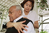 A carer has a head and neck massage during a Carers Day organised by Haringey Council in north London.
