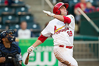 Chris Swauger (28) of the Springfield Cardinals follows through his swing during a game against the Arkansas Travelers at Hammons Field on June 13, 2012 in Springfield, Missouri. (David Welker/Four Seam Images)