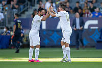 CARSON, CA - JUNE 19: Sacha Kljestan #16 of the Los Angeles Galaxy celebrates his PK goal with Sebastian Lletget #17 during a game between Seattle Sounders FC and Los Angeles Galaxy at Dignity Health Sports Park on June 19, 2021 in Carson, California.