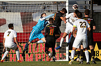 COLLEGE PARK, MD - NOVEMBER 03: Niklas Neumann #36 of Maryland punches away from Jackson Ragen #25 of Michigan during a game between Michigan and Maryland at Ludwig Field on November 03, 2019 in College Park, Maryland.