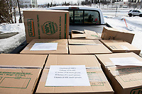 Alaska Department of Health and Social Services volunteers load medical supplies donated by UAA's College of Health outside the Allied Health Sciences Building. The supplies were taken to DHSS's warehouse in Anchorage where they will be distributed to health workers fighting the COVID-19 outbreak.