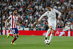 Real Madrid's Cristiano Ronaldo (R) and Atletico del Madrid´s Jesus Gamez during quarterfinal second leg Champions League soccer match at Santiago Bernabeu stadium in Madrid, Spain. April 22, 2015. (ALTERPHOTOS/Victor Blanco)
