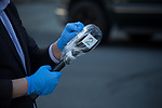 A reporter covers a microphone in plastic before conducting interviews outside of Wyckoff Heights Medical Center during the coronavirus pandemic on April 6, 2020 in New York City.  More than 10,000 people have died from COVID-19 in the U.S..  Photograph by Michael Nagle