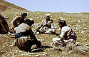 Iraq 1963 .Mustafa Barzani discussing in a field with collaborators.Irak 1963.Mustafa Barzani  assis dans un champ et discutant avec ses collaborateurs