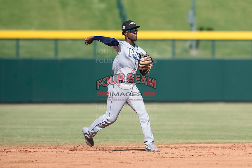 Peoria Javelinas shortstop Lucius Fox (5), of the Tampa Bay Rays organization, throws to first base during an Arizona Fall League game against the Mesa Solar Sox at Sloan Park on October 24, 2018 in Mesa, Arizona. Mesa defeated Peoria 4-3. (Zachary Lucy/Four Seam Images)