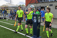 assistant referee Gianni Seeldraeyers , referee Viki De Cremer taking the matchball and assistant referee Maarten Linart entering the field befotre a female soccer game between Sporting Charleroi and Eendracht Aalst on the 8th matchday in play off 2 of the 2020 - 2021 season of Belgian Scooore Womens Super League , tuesday 18 th of May 2021 in Marcinelle , Belgium . PHOTO SPORTPIX.BE | SPP | STIJN AUDOOREN