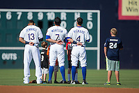 Desmond Jennings (13), Mikie Mahtook (7) and Joey Rickard (4) are joined on the field by youth baseball players for the National Anthem prior to the game against the Louisville Bats at Durham Bulls Athletic Park on August 9, 2015 in Durham, North Carolina.  The Bulls defeated the Bats 9-0.  (Brian Westerholt/Four Seam Images)